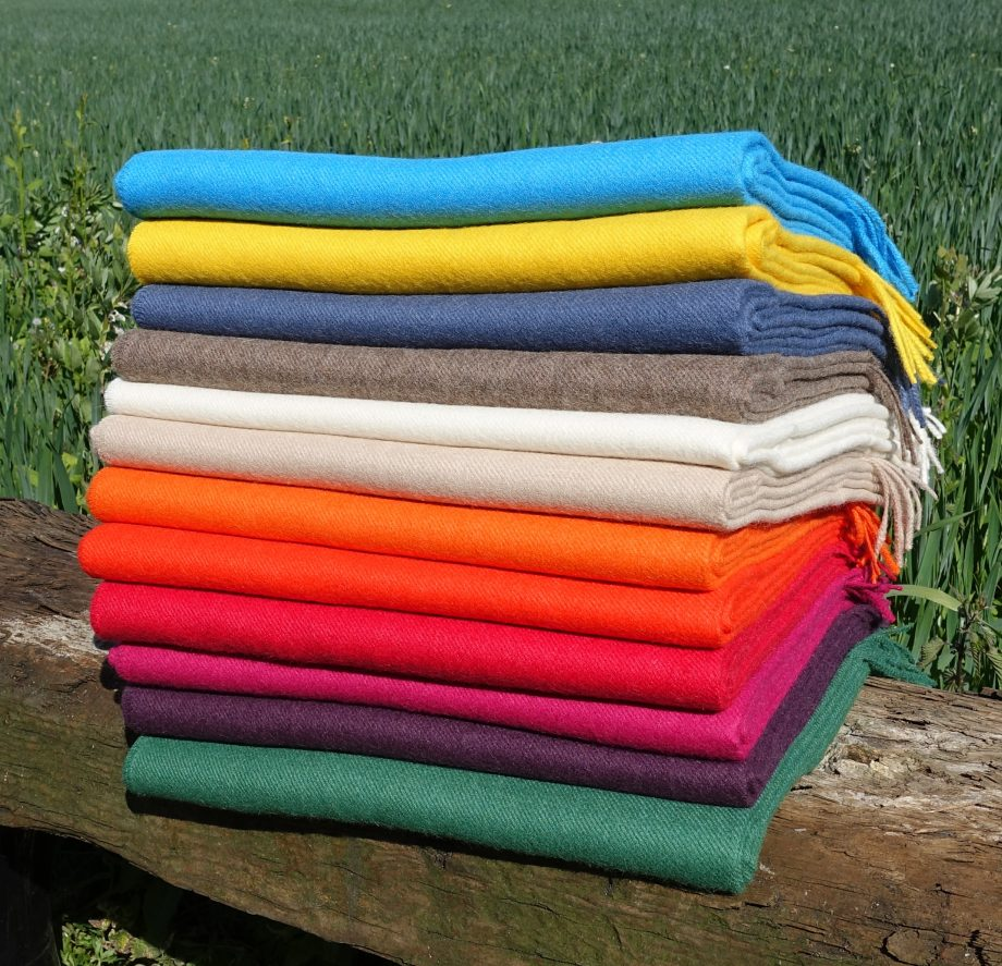 stack of plain throws